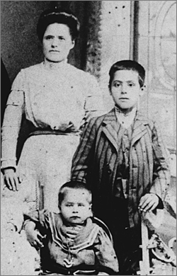 Aged 11 with his mother and brother